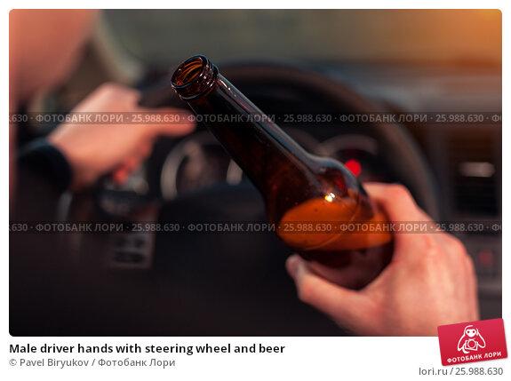 Купить «Male driver hands with steering wheel and beer», фото № 25988630, снято 21 ноября 2016 г. (c) Pavel Biryukov / Фотобанк Лори