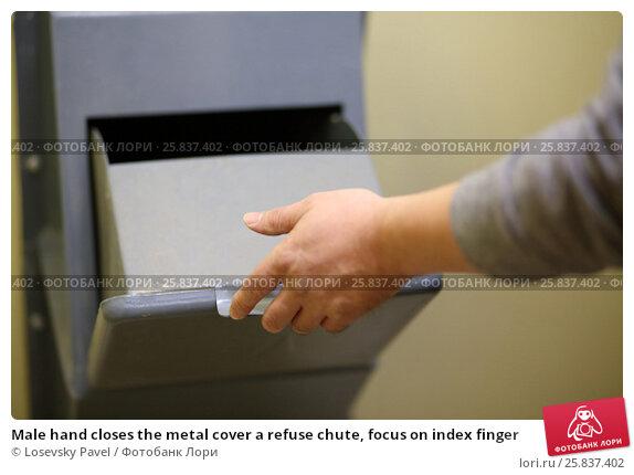 Купить «Male hand closes the metal cover a refuse chute, focus on index finger», фото № 25837402, снято 1 мая 2015 г. (c) Losevsky Pavel / Фотобанк Лори
