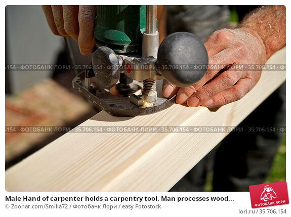 Male Hand of carpenter holds a carpentry tool. Man processes wood... Стоковое фото, фотограф Zoonar.com/Smilla72 / easy Fotostock / Фотобанк Лори