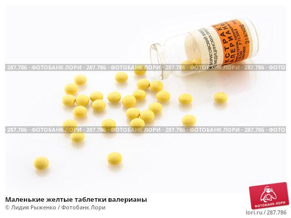 Маленькие желтые таблетки валерианы, фото № 287786, снято 16 мая 2008 г. (c) Лидия Рыженко / Фотобанк Лори