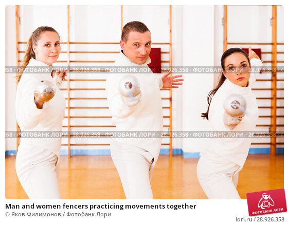 Купить «Man and women fencers practicing movements together», фото № 28926358, снято 11 июля 2018 г. (c) Яков Филимонов / Фотобанк Лори