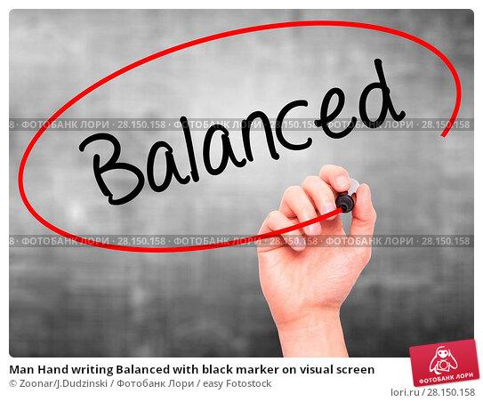 Купить «Man Hand writing Balanced with black marker on visual screen», фото № 28150158, снято 20 июня 2018 г. (c) easy Fotostock / Фотобанк Лори