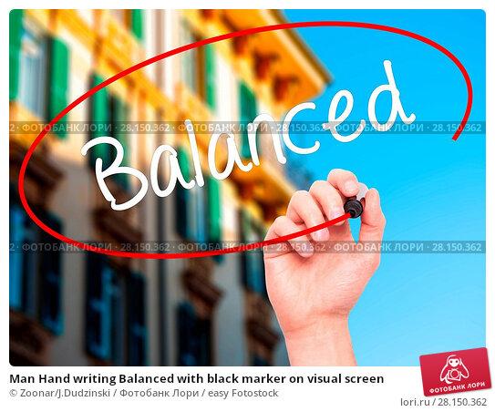 Купить «Man Hand writing Balanced with black marker on visual screen», фото № 28150362, снято 21 июня 2018 г. (c) easy Fotostock / Фотобанк Лори