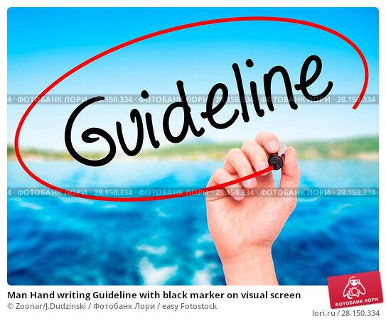 Купить «Man Hand writing Guideline with black marker on visual screen», фото № 28150334, снято 18 июня 2018 г. (c) easy Fotostock / Фотобанк Лори