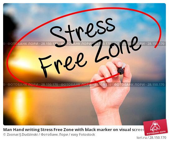 Купить «Man Hand writing Stress Free Zone with black marker on visual screen», фото № 28150170, снято 20 июня 2018 г. (c) easy Fotostock / Фотобанк Лори