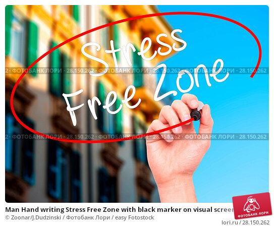 Купить «Man Hand writing Stress Free Zone with black marker on visual screen», фото № 28150262, снято 21 июня 2018 г. (c) easy Fotostock / Фотобанк Лори