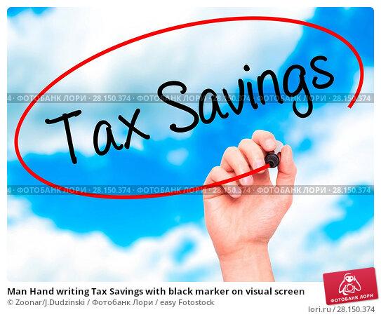 Купить «Man Hand writing Tax Savings with black marker on visual screen», фото № 28150374, снято 20 июня 2018 г. (c) easy Fotostock / Фотобанк Лори