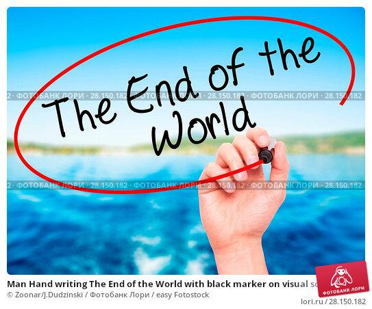 Купить «Man Hand writing The End of the World with black marker on visual screen», фото № 28150182, снято 19 июня 2018 г. (c) easy Fotostock / Фотобанк Лори