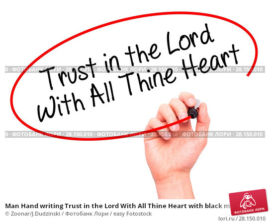 Купить «Man Hand writing Trust in the Lord With All Thine Heart with black marker on visual screen», фото № 28150010, снято 19 июня 2018 г. (c) easy Fotostock / Фотобанк Лори