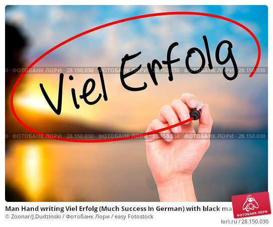 Купить «Man Hand writing Viel Erfolg (Much Success In German) with black marker on visual screen», фото № 28150030, снято 19 июня 2018 г. (c) easy Fotostock / Фотобанк Лори
