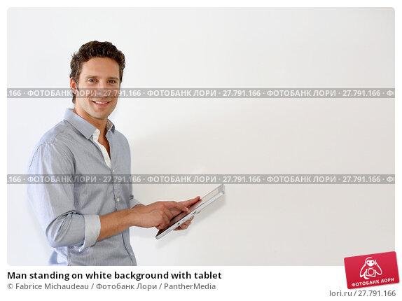 Купить «Man standing on white background with tablet», фото № 27791166, снято 22 февраля 2018 г. (c) PantherMedia / Фотобанк Лори