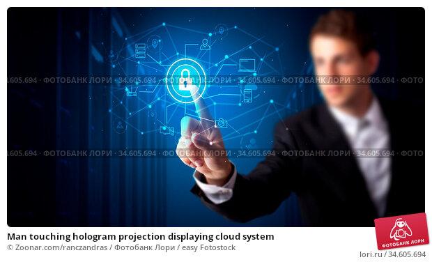 Man touching hologram projection displaying cloud system. Стоковое фото, фотограф Zoonar.com/ranczandras / easy Fotostock / Фотобанк Лори
