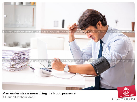 Купить «Man under stress measuring his blood pressure», фото № 29889834, снято 28 июля 2018 г. (c) Elnur / Фотобанк Лори