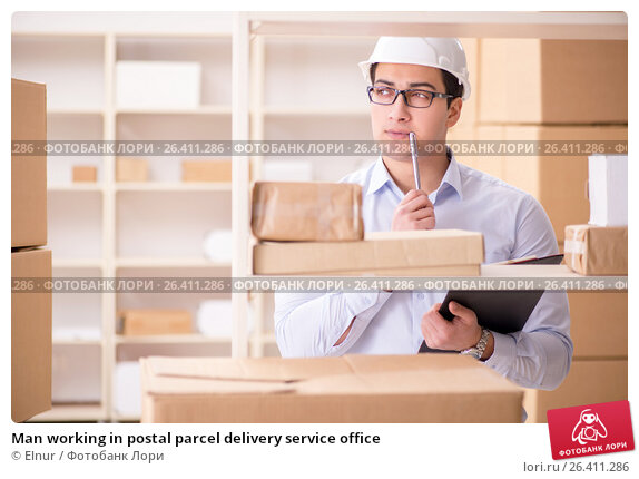 Купить «Man working in postal parcel delivery service office», фото № 26411286, снято 13 февраля 2017 г. (c) Elnur / Фотобанк Лори