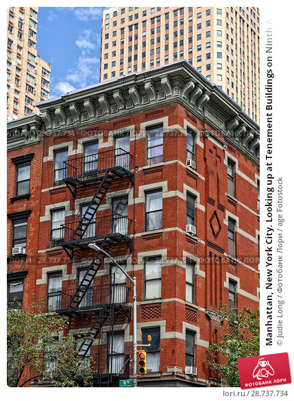 Купить «Manhattan, New York City. Looking up at Tenement Buildings on Ninth Avenue in the Clinton/Hell's Kitchen Neighborhood, Contrasting New Skyscrapers in the Background.», фото № 28737734, снято 7 июня 2018 г. (c) age Fotostock / Фотобанк Лори