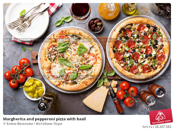 Margherita and pepperoni pizza with basil. Стоковое фото, фотограф Елена Веселова / Фотобанк Лори