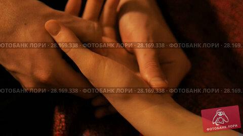 Купить «Masseur doing hand massage for female client», видеоролик № 28169338, снято 23 февраля 2018 г. (c) Aleksey Popov / Фотобанк Лори