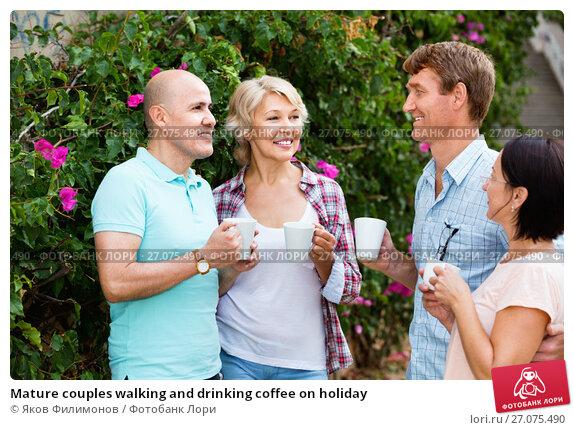 Mature couples walking and drinking coffee on holiday, фото № 27075490, снято 25 июля 2017 г. (c) Яков Филимонов / Фотобанк Лори