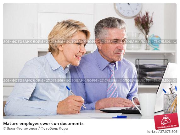 Купить «Mature employees work on documents», фото № 27075506, снято 11 декабря 2017 г. (c) Яков Филимонов / Фотобанк Лори