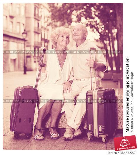 Купить «Mature spouses enjoying joint vacation», фото № 28455582, снято 27 августа 2017 г. (c) Яков Филимонов / Фотобанк Лори