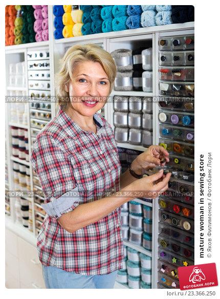 Купить «mature woman in sewing store», фото № 23366250, снято 20 мая 2019 г. (c) Яков Филимонов / Фотобанк Лори