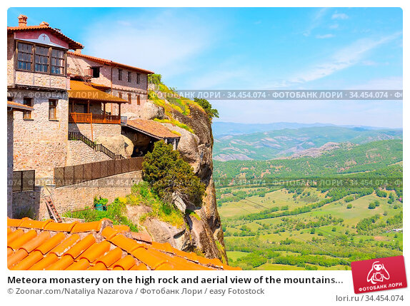 Meteora monastery on the high rock and aerial view of the mountains... Стоковое фото, фотограф Zoonar.com/Nataliya Nazarova / easy Fotostock / Фотобанк Лори