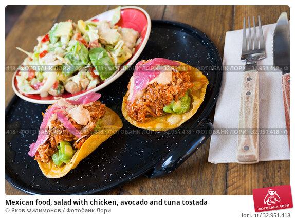 Mexican food, salad with chicken, avocado and tuna tostada. Стоковое фото, фотограф Яков Филимонов / Фотобанк Лори