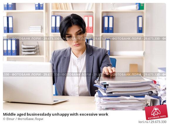 Купить «Middle aged businesslady unhappy with excessive work», фото № 29673330, снято 15 ноября 2018 г. (c) Elnur / Фотобанк Лори