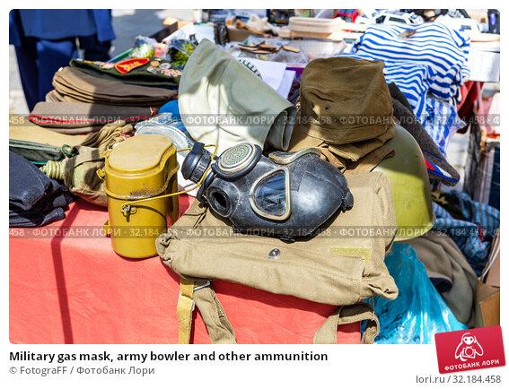 Купить «Military gas mask, army bowler and other ammunition», фото № 32184458, снято 9 мая 2018 г. (c) FotograFF / Фотобанк Лори