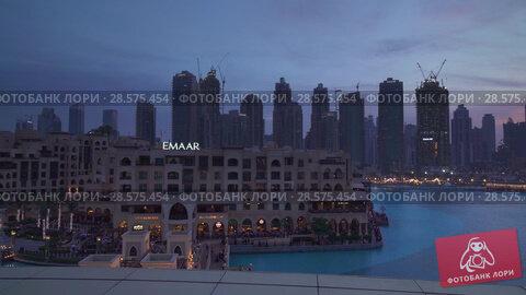 Купить «Modern architecture Downtown Dubai around the Burj Khalifa Lake at sunset stock footage video», видеоролик № 28575454, снято 8 апреля 2018 г. (c) Юлия Машкова / Фотобанк Лори
