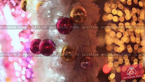 Купить «Moscow. Christmas. Toys-balls in white festive splendor, scenery from garlands and lights of illuminations on a city street. New Year theme.», видеоролик № 26517534, снято 4 апреля 2017 г. (c) Mikhail Davidovich / Фотобанк Лори