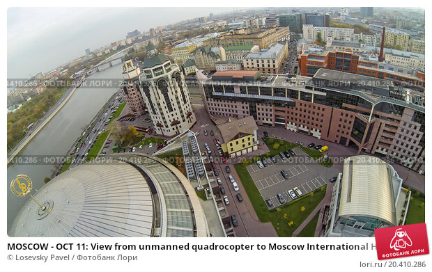 Купить «MOSCOW - OCT 11: View from unmanned quadrocopter to Moscow International House of Music with treble clef on the roof and Business complex Riverside Towers on October 11, 2013 in Moscow, Russia.», фото № 20410286, снято 11 октября 2013 г. (c) Losevsky Pavel / Фотобанк Лори