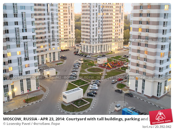 Купить «MOSCOW, RUSSIA - APR 23, 2014: Courtyard with tall buildings, parking and playgrounds in modern residential complex Elk Island in the evening, top view», фото № 20392042, снято 23 апреля 2014 г. (c) Losevsky Pavel / Фотобанк Лори