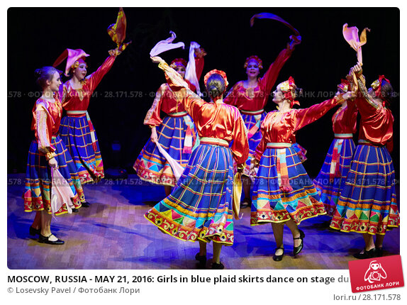 Купить «MOSCOW, RUSSIA - MAY 21, 2016: Girls in blue plaid skirts dance on stage during concert of dance studio Firebird in Bogorodskoye», фото № 28171578, снято 21 мая 2016 г. (c) Losevsky Pavel / Фотобанк Лори