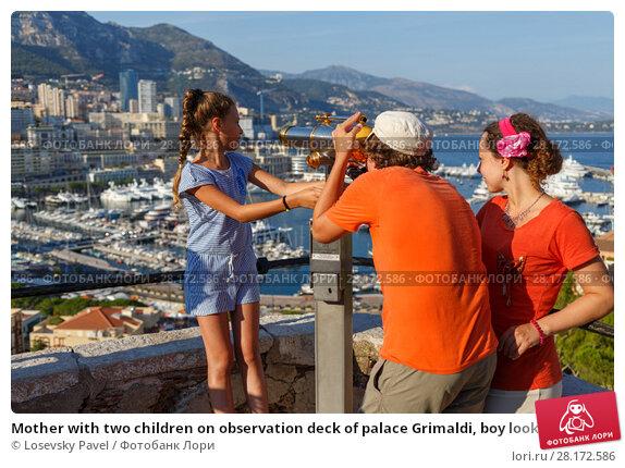 Купить «Mother with two children on observation deck of palace Grimaldi, boy looks through binoculars», фото № 28172586, снято 3 августа 2016 г. (c) Losevsky Pavel / Фотобанк Лори