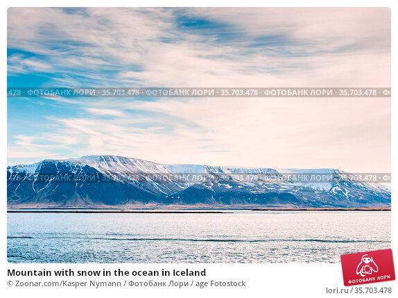 Mountain with snow in the ocean in Iceland. Стоковое фото, фотограф Zoonar.com/Kasper Nymann / age Fotostock / Фотобанк Лори