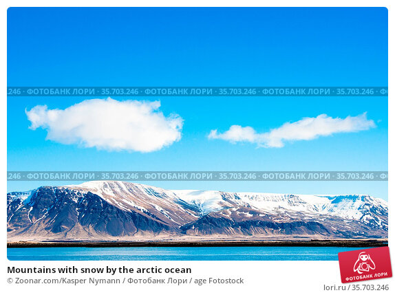 Mountains with snow by the arctic ocean. Стоковое фото, фотограф Zoonar.com/Kasper Nymann / age Fotostock / Фотобанк Лори