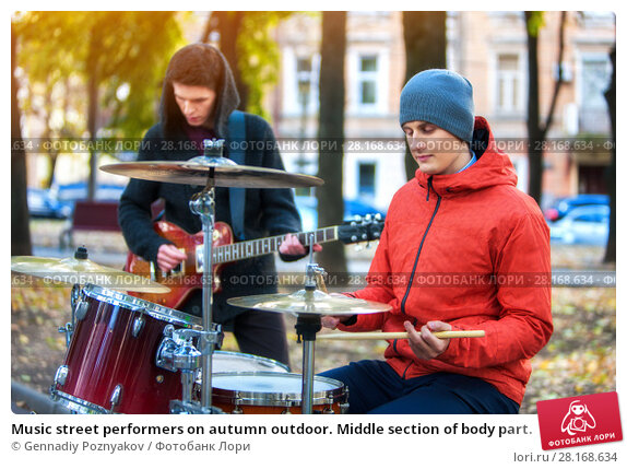 Купить «Music street performers on autumn outdoor. Middle section of body part.», фото № 28168634, снято 8 октября 2015 г. (c) Gennadiy Poznyakov / Фотобанк Лори