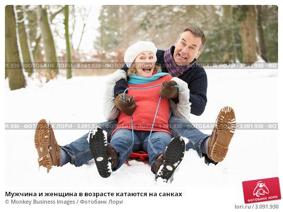 Купить «Мужчина и женщина в возрасте катаются на санках», фото № 3091930, снято 12 января 2010 г. (c) Monkey Business Images / Фотобанк Лори