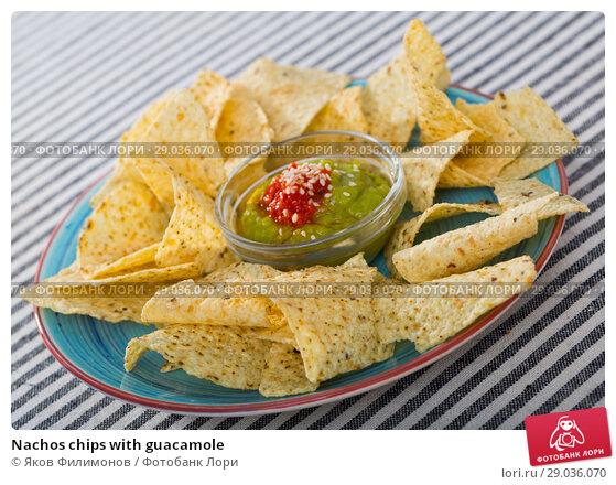 Купить «Nachos chips with guacamole», фото № 29036070, снято 18 февраля 2019 г. (c) Яков Филимонов / Фотобанк Лори