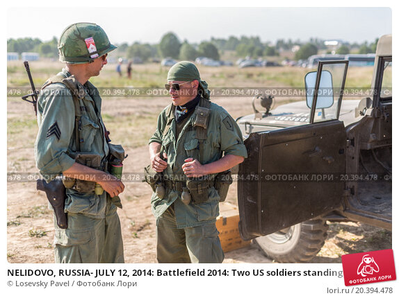 Купить «NELIDOVO, RUSSIA- JULY 12, 2014: Battlefield 2014: Two US soldiers standing near the car», фото № 20394478, снято 12 июля 2014 г. (c) Losevsky Pavel / Фотобанк Лори