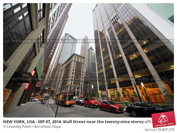 Купить «NEW YORK, USA - SEP 07, 2014: Wall Street near the twenty-nine-storey office building in New York», фото № 25837270, снято 7 сентября 2014 г. (c) Losevsky Pavel / Фотобанк Лори