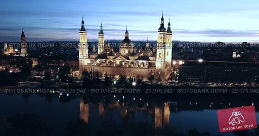 Купить «Night aerial view of Saragossa with Cathedral Basilica of Our Lady, Spain», видеоролик № 29976942, снято 19 декабря 2018 г. (c) Яков Филимонов / Фотобанк Лори