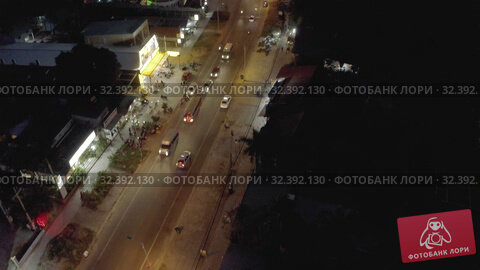 Купить «Night City life, Cars and bikes traffic on asphalt road in Vietnam 4K Drone shot», видеоролик № 32392130, снято 4 ноября 2019 г. (c) Aleksejs Bergmanis / Фотобанк Лори