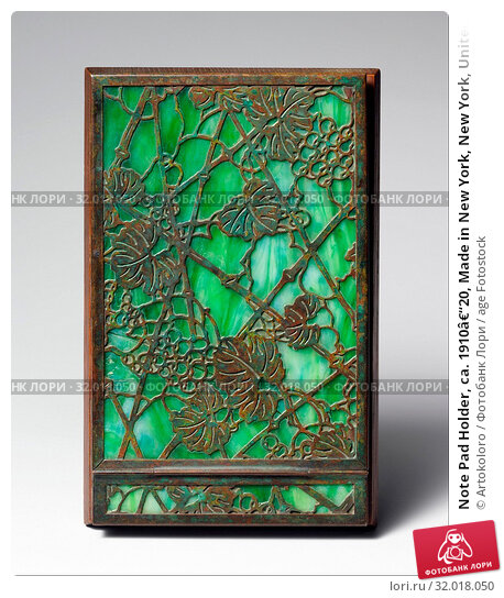 Купить «Note Pad Holder, ca. 1910–20, Made in New York, New York, United States, American, Favrile glass, bronze, wood, 7 3/4 x 4 15/16 in. (19.7 x 12.5 cm), Metal, Tiffany Studios (1902–32)», фото № 32018050, снято 21 февраля 2017 г. (c) age Fotostock / Фотобанк Лори
