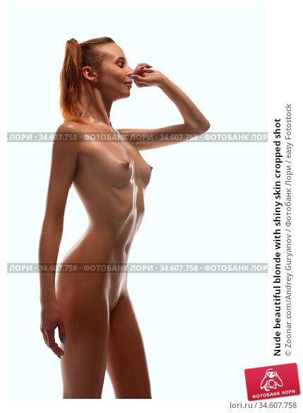 Nude beautiful blonde with shiny skin cropped shot. Стоковое фото, фотограф Zoonar.com/Andrey Guryanov / easy Fotostock / Фотобанк Лори