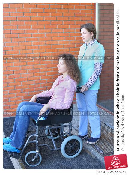 Купить «Nurse and patient in wheelchair in front of main entrance in medical facility, focus on nurse», фото № 25837234, снято 19 марта 2015 г. (c) Losevsky Pavel / Фотобанк Лори