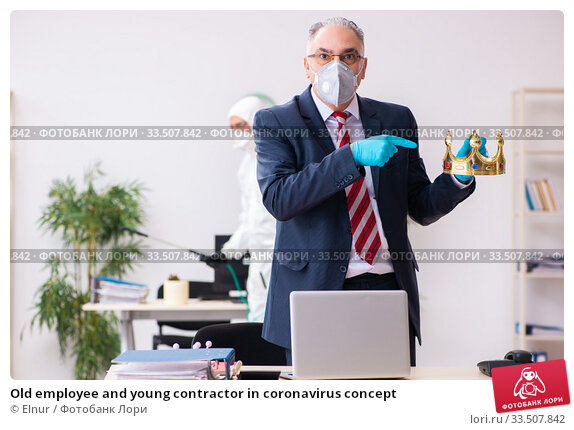Old employee and young contractor in coronavirus concept. Стоковое фото, фотограф Elnur / Фотобанк Лори