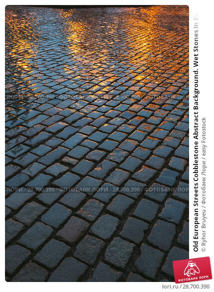 Купить «Old European Streets Cobblestone Abstract Background. Wet Stones In Evening Or Night Illuminations. Travel Abstract Background.», фото № 28700390, снято 3 июля 2016 г. (c) easy Fotostock / Фотобанк Лори