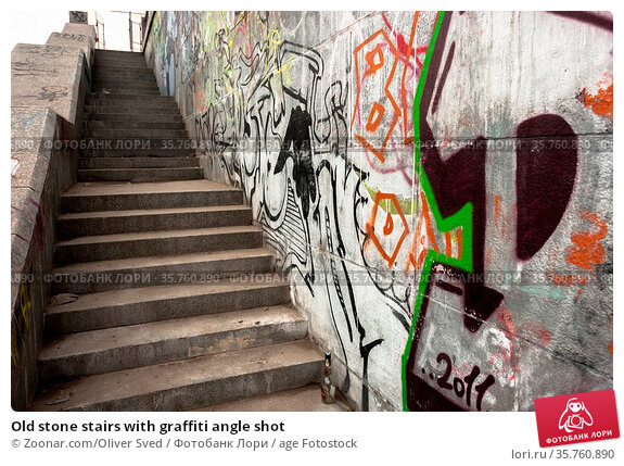Old stone stairs with graffiti angle shot. Стоковое фото, фотограф Zoonar.com/Oliver Sved / age Fotostock / Фотобанк Лори
